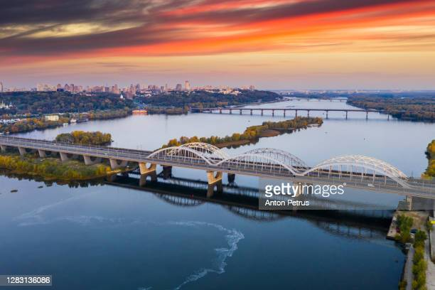bridge across the dnieper river. kiev, ukraine - ukraine stock pictures, royalty-free photos & images