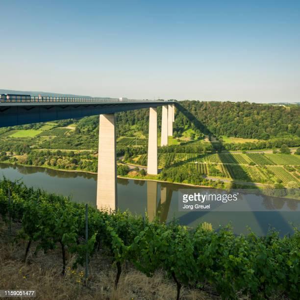 bridge across the moselle river - moselle stock-fotos und bilder