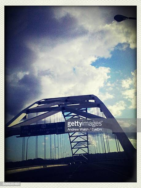 bridge against cloudy sky - transferbild stock-fotos und bilder