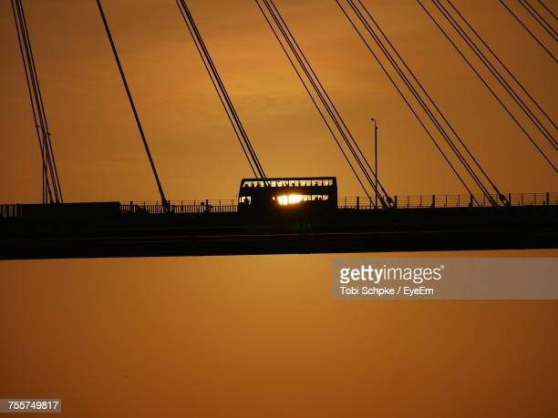 bridge against sky during sunset - double decker bus stock pictures, royalty-free photos & images