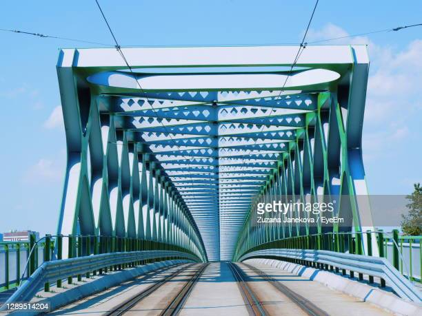 bridge against sky in city - slovakia stock pictures, royalty-free photos & images