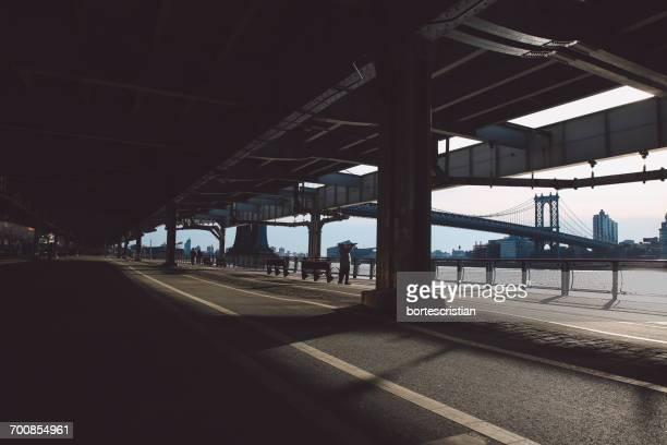 bridge against sky - bortes stockfoto's en -beelden