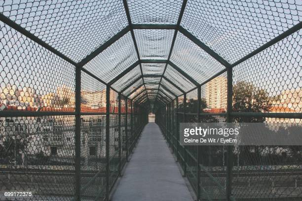 Bridge Against Sky Seen Through Chainlink Fence