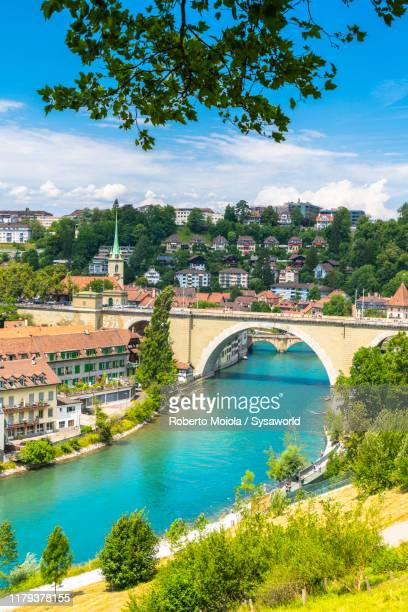 bridge along aare river, bern, switzerland - unesco stockfoto's en -beelden