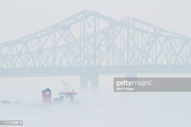 bridge and boat in fog - gulf coast states stockfoto's en -beelden