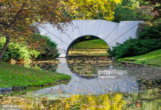 bridge at dow gardens in midland michigan - midland michigan stock pictures, royalty-free photos & images