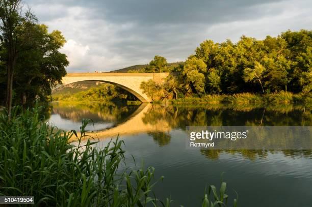 bridge at greoux les bains - alpes de haute provence stock photos and pictures