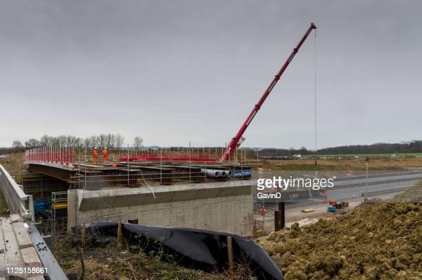bridge being built at junction 10a of m20 in kent - ashford kent stock photos and pictures