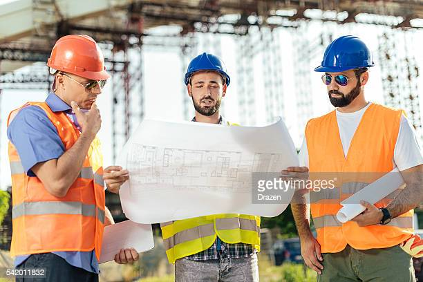 bridge building and residential complex development - civil engineering stock photos and pictures