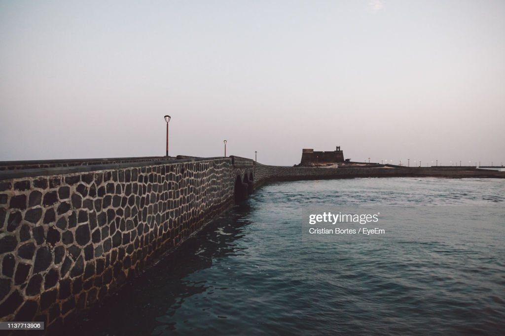 Bridge By Sea Against Clear Sky During Sunset : Stock Photo