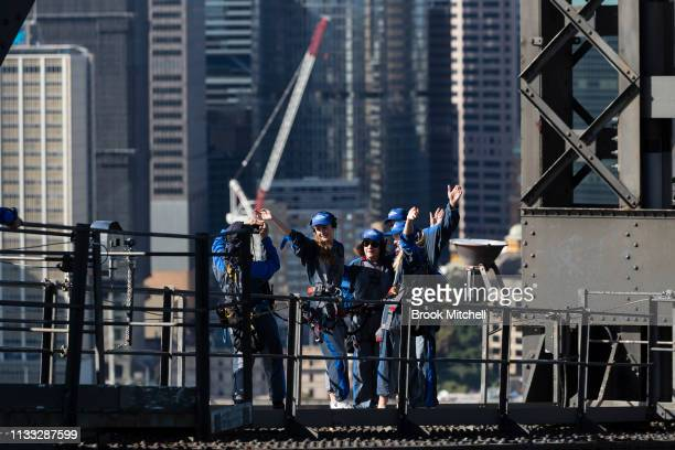 Bridge climbers pause for a photo on March 03 2019 in Sydney Australia The Clean Up Sydney Harbour event was founded by the late Ian Kiernan in 1989...
