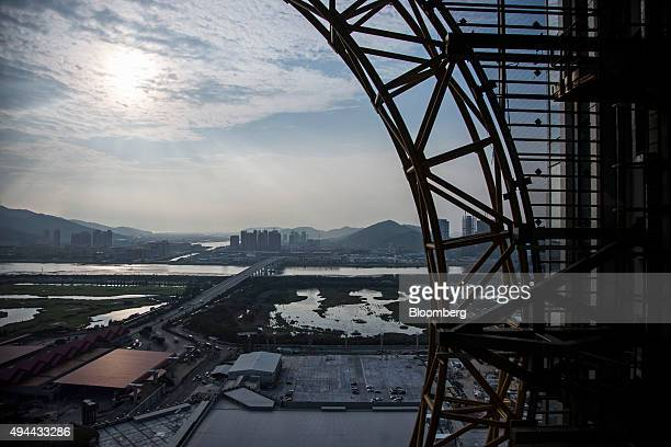 A bridge connecting Macau and Zhuhai is seen from a passenger pod of the Golden Reel ferris wheel at Studio City casino resort developed by Melco...