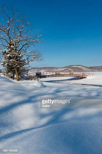 A bridge covered with snow in a park at the frozen Lake Abashiriko near Abashiri a city on Hokkaido Island Japan