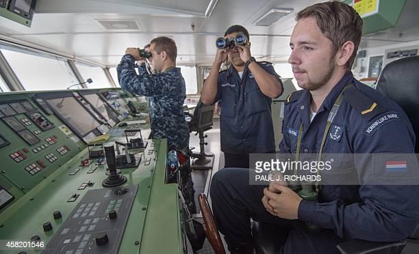 Bridge crewmen aboard the Dutch ship HNLMS Johan de Witt including a US Navy Officer on loan for the NATO exercise perform their duties during Bold...