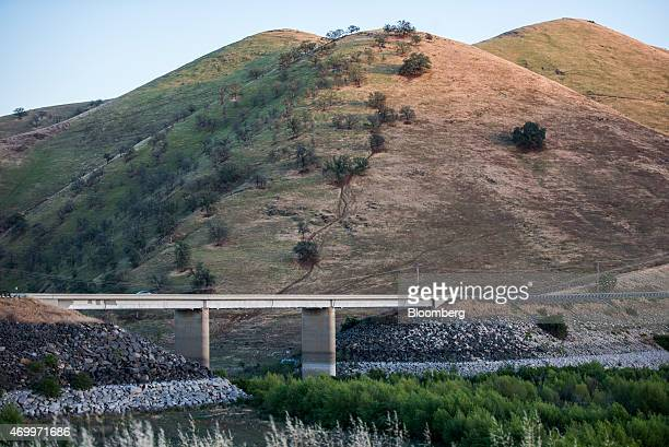 A bridge crosses over a dried up section of Lake Success in Porterville California US on Monday April 13 2015 In a handful of droughtplagued...