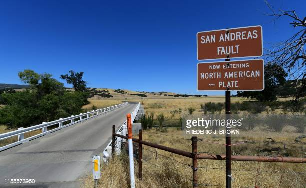 A bridge crosses over the San Andreas Fault from the Pacific to the North American tectonic plates near Parkfield California on July 12 2019 in a...