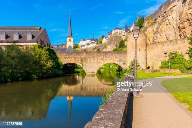bridge crossing alzette river in luxembourg city - ルクセンブルク ストックフォトと画像