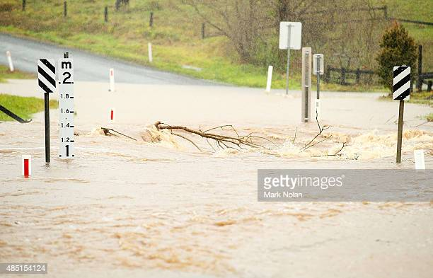 A bridge crossing downstream of Jerrara dam is cutt by flood waters during flooding effecting the area on August 25 2015 in Kiama Australia Residents...