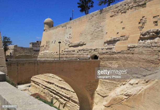 Bridge crossing moat to fortified city walls Saint James bastion Valletta Malta