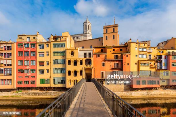 bridge crossing river in gerona spain - spain stock pictures, royalty-free photos & images