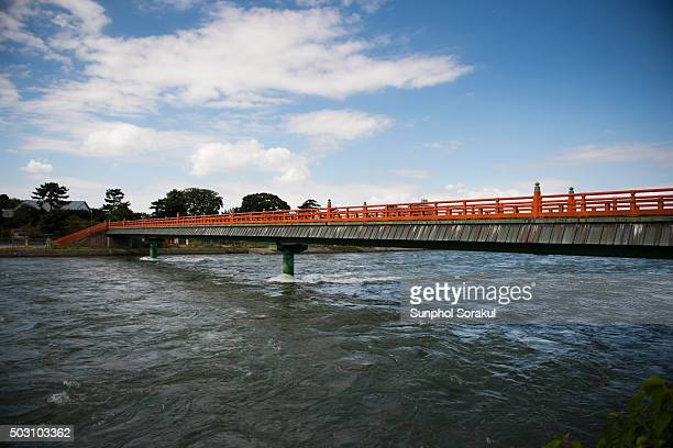 bridge crossing uji river during high tide - uji kyoto stock pictures, royalty-free photos & images
