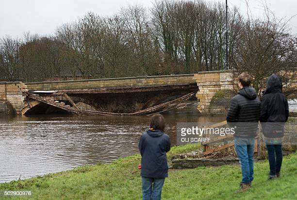 A bridge damaged by floodwater is pictured over the River Wharfe in Tadcaster in northern England on December 30 2015 With more floods forecast...