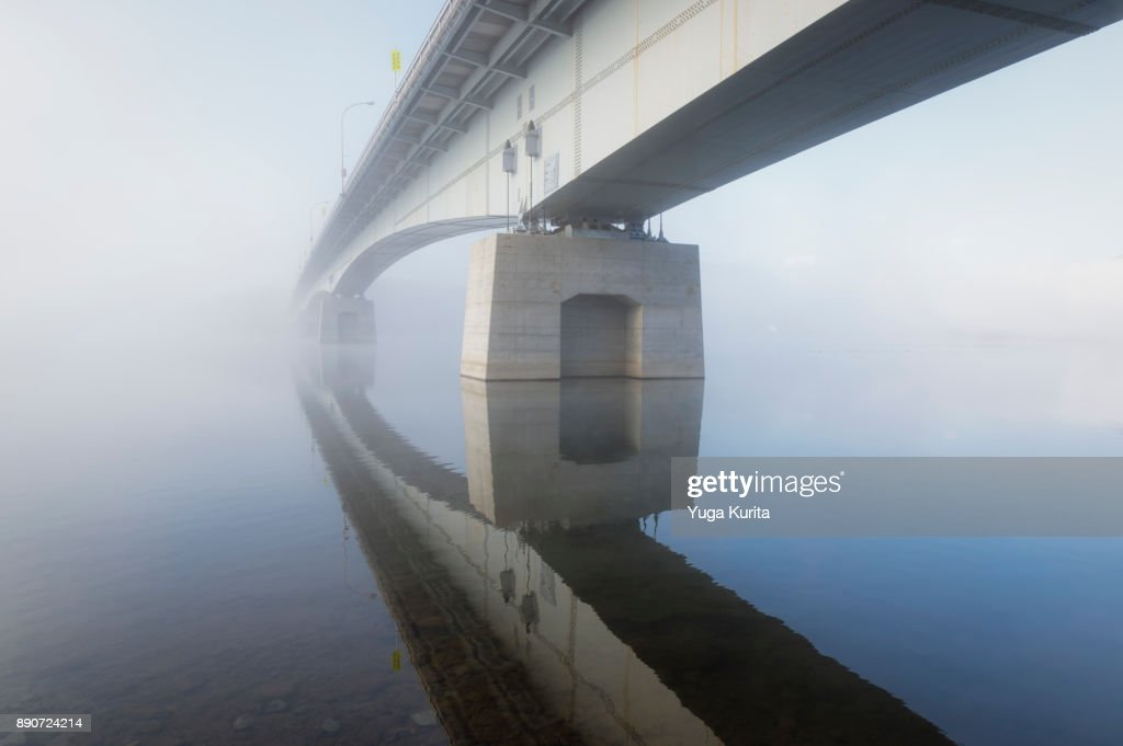 Bridge Fading Into a Fog : ストックフォト