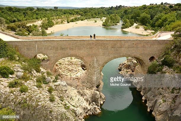 bridge. herault gorges. saint-guilhem-le-desert. - herault stock photos and pictures