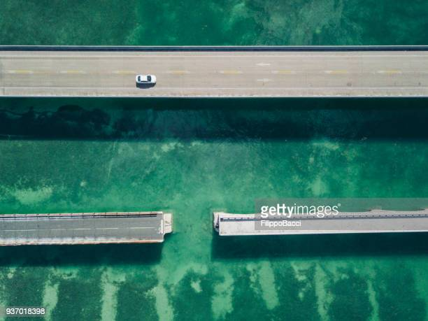 bridge in florida keys from drone point of view - parallel stock photos and pictures