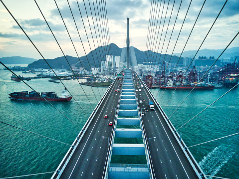 Bridge in Hong Kong and Container Cargo freight ship 1058737714