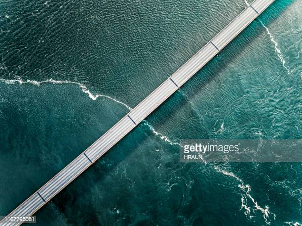 bridge in iceland going over the sea seen from above - iceland stock pictures, royalty-free photos & images