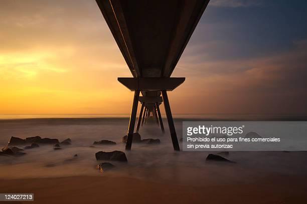 Bridge in sunset beach