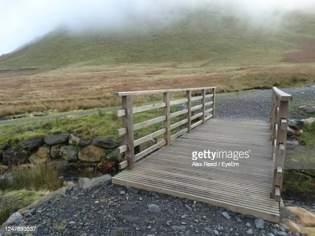 bridge in the countryside. - alex reed stock pictures, royalty-free photos & images