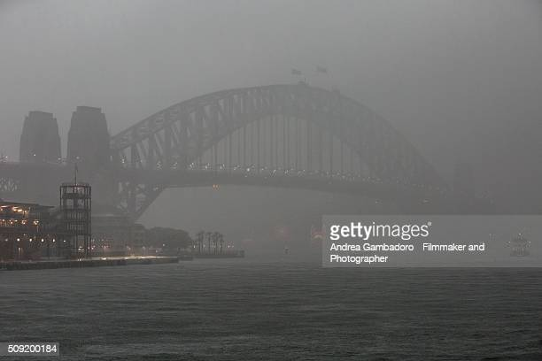 bridge in the mist - sydney rain stock pictures, royalty-free photos & images