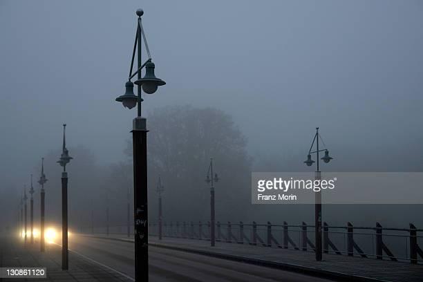 Bridge in the morning fog with cars, Tierparkbruecke bridge, Munich, Bavaria, Germany, Europe
