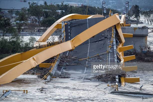 A bridge lies destroyed after being hit by a tsunami on October 01 2018 in Palu Indonesia Over 844 people have been confirmed dead after a tsunami...