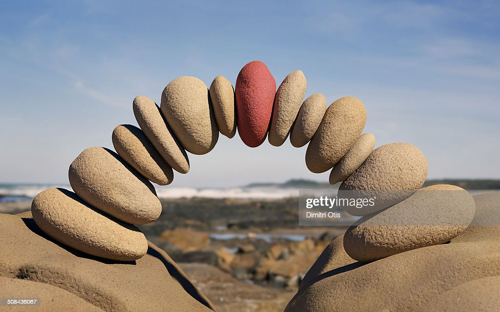 Bridge made from stones, red one in centre : Stock Photo