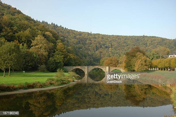 Bridge mirrored in River Semois Wallonia Belgium