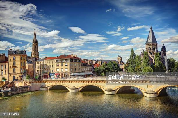 bridge 'moyen pont' and the church 'temple neuf' and the bell tower of the saint-vincent basilica - lorraine stock pictures, royalty-free photos & images
