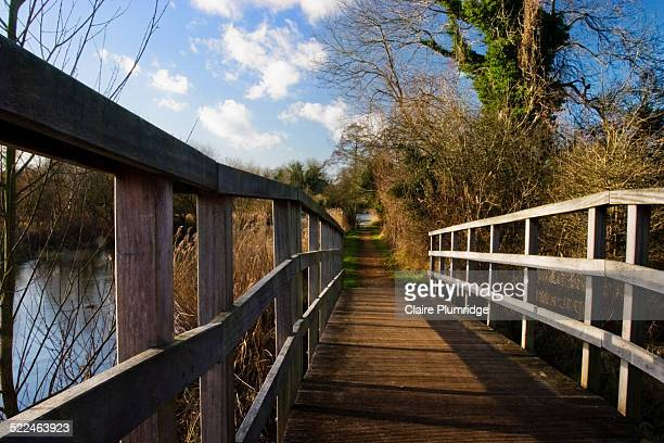 bridge next to canal - claire plumridge stock pictures, royalty-free photos & images