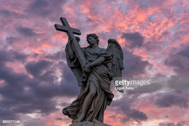 bridge of angels statue at sunrise - angel stock pictures, royalty-free photos & images