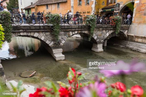 A bridge of the old town of Annecy where the Thiou river is formed by the Annecy Lake water on October 6 2018 in Annecy France Lake Annecy has...