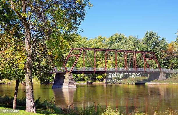 bridge on peaceful river - iowa stock pictures, royalty-free photos & images