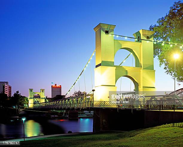 bridge over a river at night - waco stock pictures, royalty-free photos & images