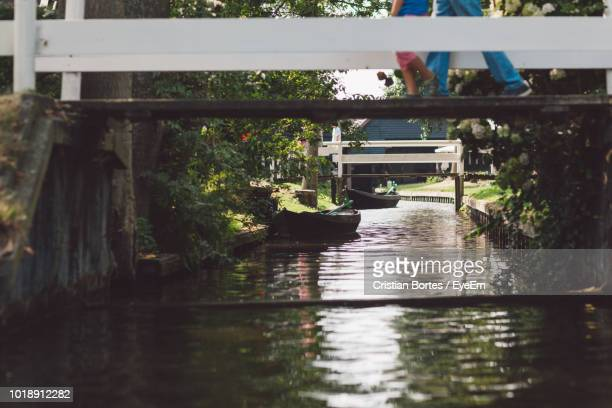 bridge over canal against trees - bortes stock pictures, royalty-free photos & images