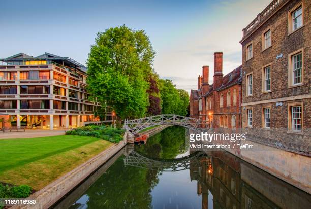 bridge over canal amidst buildings against sky - cambridge stock pictures, royalty-free photos & images