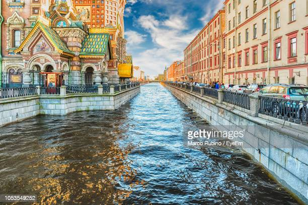 bridge over canal amidst buildings in city - サンクトペテルブルク ストックフォトと画像