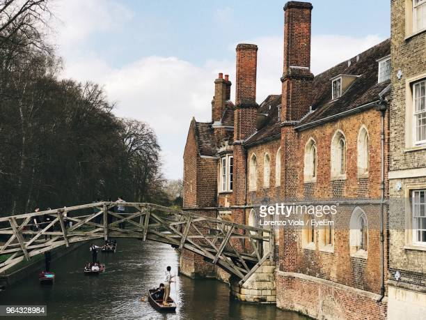 bridge over canal by buildings against sky - cambridge england stock pictures, royalty-free photos & images