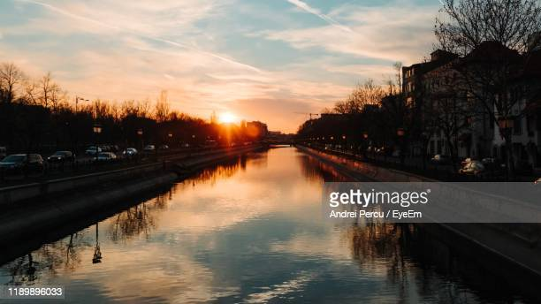 bridge over canal in city against sky at sunset - bucharest stock pictures, royalty-free photos & images