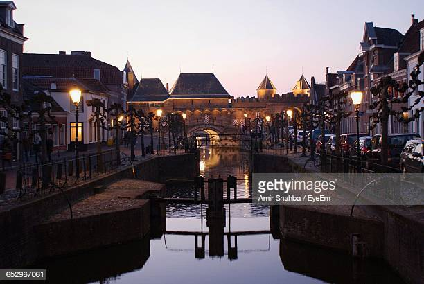 bridge over canal in city - amersfoort netherlands stock photos and pictures